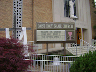 the welcoming sign in front of Holy Name Church photo courtesy of Dave Shaw