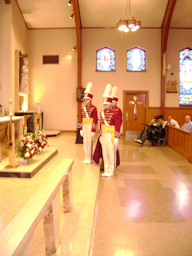 the honor guard facing the pulpit for the singing of the Holy Name Hymn photo courtesy of Dave Shaw